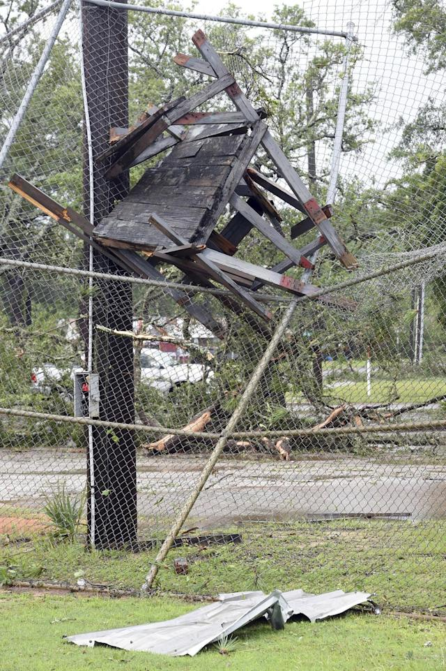 <p>A wooden structure is embedded in backstop of a baseball field in Fort Walton Beach, Fla., June 21, 2017. A line of severe weather from Tropical Storm Cindy battered this northwest Florida community early Wednesday morning. (Photo: Devon Ravine/Northwest Florida Daily News via AP) </p>