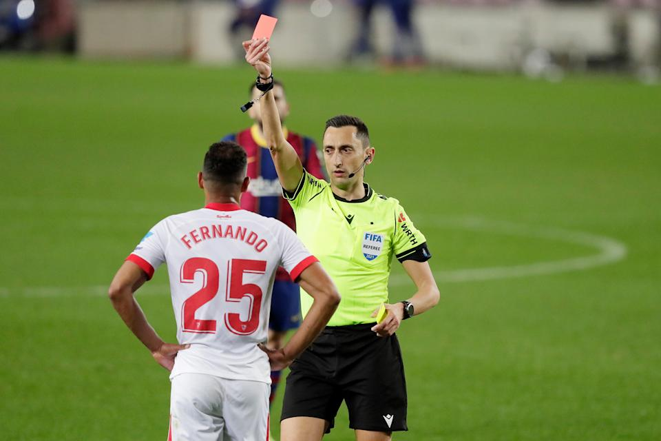 BARCELONA, SPAIN - MARCH 3: Fernando Reges of Sevilla FC receives red card during the Spanish Copa del Rey  match between FC Barcelona v Sevilla at the Camp Nou on March 3, 2021 in Barcelona Spain (Photo by David S. Bustamante/Soccrates/Getty Images)