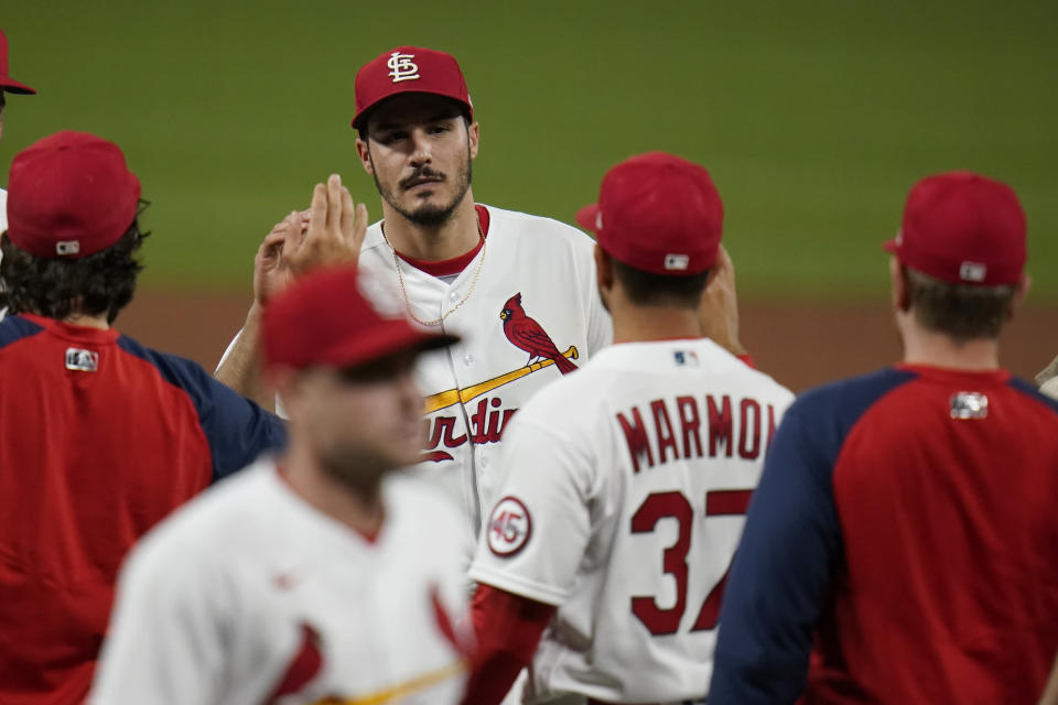 St. Louis Cardinals' Nolan Arenado celebrates a 5-2 victory over the Pittsburgh Pirates in a baseball game Tuesday, May 18, 2021, in St. Louis. (AP Photo/Jeff Roberson)