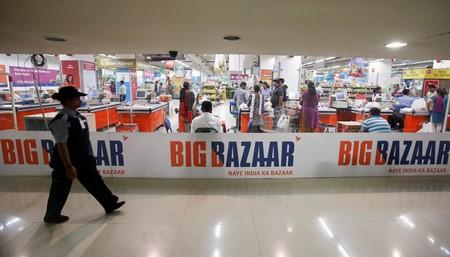 FILE PHOTO: A security personnel walks past the Big Bazaar retail store in Mumbai