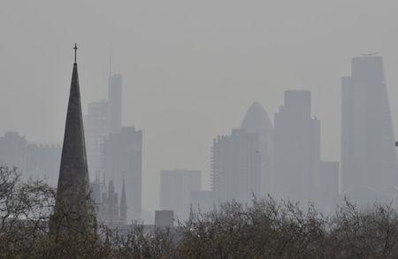 City of London financial district is seen from Primrose Hill as high air pollution obscures the skyline over London