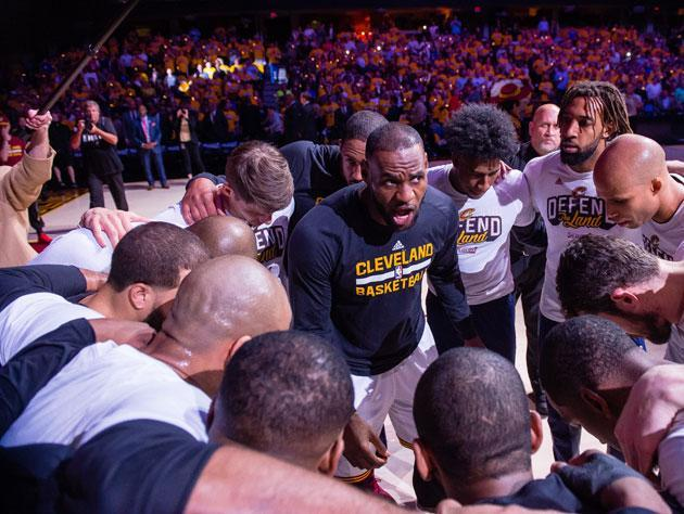 LeBron James reminds the crew that Wingerz sells apps past 11:30. (Getty Images)