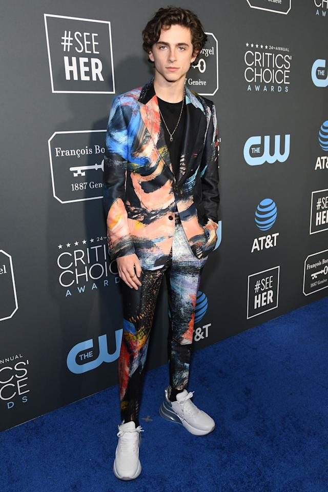 """Lest we forget this very important sneaker moment at the <a href=""""https://people.com/tv/amy-adams-patricia-arquette-tie-critics-choice-awards-2019/"""">24th Annual Critics' Choice Awards</a>. The budding fashion icon teamed his crisp white kicks with an Alexander McQueen two-piece suit covered in multicolored paint strokes. (Which reminded us ofthat <em>other</em> <a href=""""https://people.com/style/timothee-chalamet-suits-photos/"""">Alexander McQueen floral-print suit he wore last year</a>.) His commitment to the look, and the way he accessorized it with a delicate pendant necklace, meant it was an immediate addition to this list."""