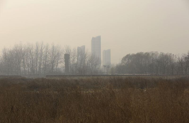 An empty field, which was purchased by a Chinese real estate developer for 3.3 billion yuan ($515 million) in November, is pictured on a hazy day in Beijing