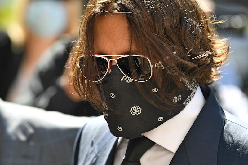 Hollywood actor Johnny Depp, wearing a face mask or covering due to the COVID-19 pandemic, arrives on the first day of his libel trial against News Group Newspapers (NGN), at the High Court in London, on July 7, 2020. - A libel trial was due to begin on Tuesday between Hollywood actor Johnny Depp and a British tabloid newspaper over claims that he was violent to his former wife, Amber Heard.
