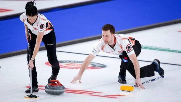 Kerri Einrson, left, and Brad Gushue, right, seen here on March 24, remain tied at the top of the Group A standings. (Jeff McIntosh/The Canadian Press - image credit)