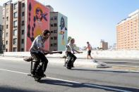 Vinicius Sanctus and Alessandro Russo ride electric monowheels called 'nuvem' (cloud) that were invented by them and inspired by the magic flying brooms of the Harry Potter series in Sao Paulo