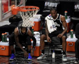 Paul George #13 along with teammate Kawhi Leonard #2 of the LA Clippers on the bench look on in the fourth quarter of game three of the Western Conference second-round NBA basketball playoff basketball game against the Utah Jazz at the Staples Center in Los Angeles on Saturday, June 12, 2021. (Keith Birmingham/The Orange County Register via AP)