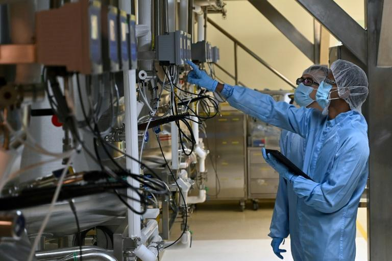Biochemists check a bio-reactor used for manufacturing medical products at Takeda Pharmaceuticals (Asia Pacific) in Singapore. Among its products, Takeda's facility grows cells from hamster ovaries to make ingredients for drugs to treat haemophilia