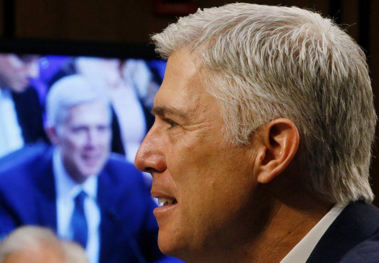 U.S. Supreme Court nominee judge Neil Gorsuch is seen on a video monitor as he testifies.