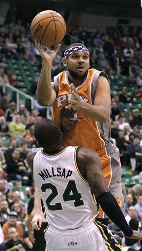 Phoenix Suns shooting guard Jared Dudley (3) charges in to Utah Jazz power forward Paul Millsap (24) in the first quarter during an NBA basketball game on Saturday, Nov. 10, 2012, in Salt Lake City. (AP Photo/Rick Bowmer)