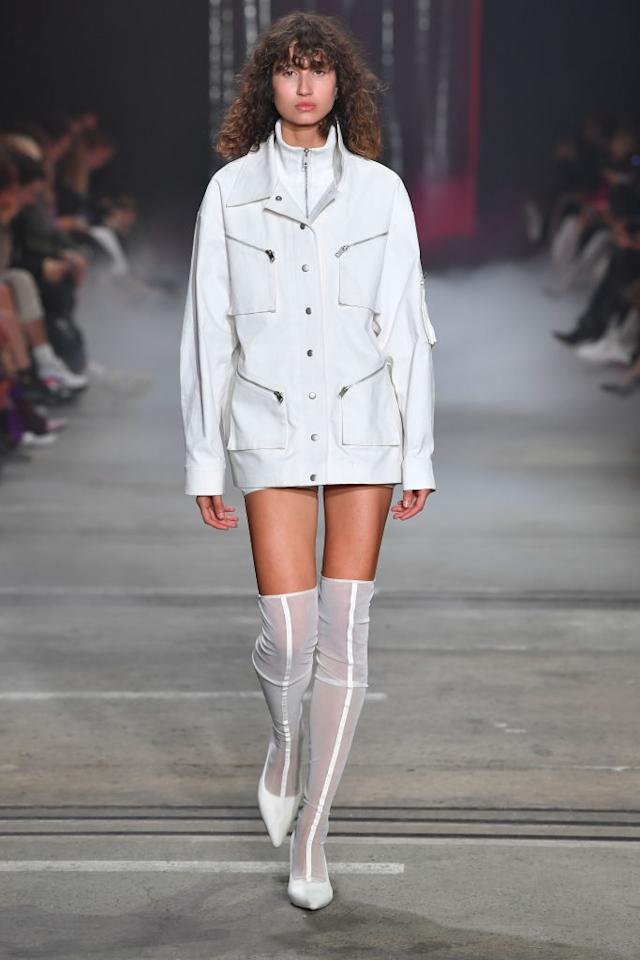 <p>A model walks the runway wearing a white minidress during the I.AM.GIA show at Mercedes-Benz Fashion Week Australia Resort 19 Collections at Carriageworks on May 16, 2018, in Sydney, Australia. (Photo: Getty Images) </p>