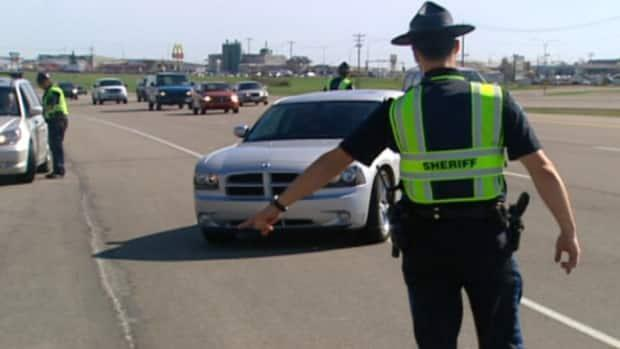 The Alberta government says giving highway patrol sheriffs more authority will help the RCMP focus on higher-priority criminal matters. (CBC - image credit)