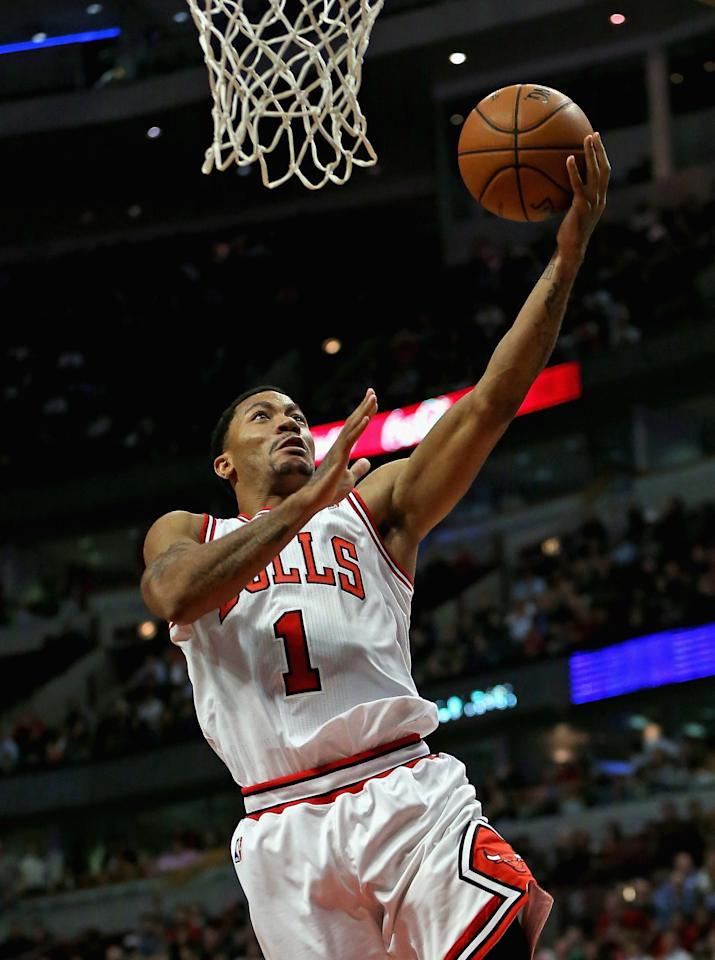 CHICAGO, IL - NOVEMBER 18: Derrick Rose #1 of the Chicago Bulls drives to the basket against the Charlotte Bobcats at the United Center on November 18, 2013 in Chicago, Illinois. The Bulls defeated the Bobcats 86-81. NOTE TO USER: User expressly acknowledges and agrees that, by downloading and or using this photograph, User is consenting to the terms and conditions of the Getty Images License Agreement. (Photo by Jonathan Daniel/Getty Images)