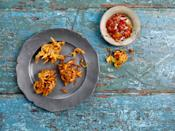 "For these fritters, you'll use a lot of seasoned fresh vegetables, which are mixed together with ground rice and chickpea flour to create a very light batter. The recipe calls for onions, cabbage, potato and carrot, but you can use whatever combination of vegetables you've got sitting in the fridge. <a href=""https://www.epicurious.com/recipes/food/views/shabzi-pakora?mbid=synd_yahoo_rss"" rel=""nofollow noopener"" target=""_blank"" data-ylk=""slk:See recipe."" class=""link rapid-noclick-resp"">See recipe.</a>"