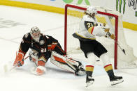 Vegas Golden Knights center William Karlsson, right, scores the game-winner past Anaheim Ducks goaltender John Gibson during overtime in an NHL hockey game Saturday, Feb. 27, 2021, in Anaheim, Calif. The Golden Knights won 3-2 in overtime. (AP Photo/Mark J. Terrill)