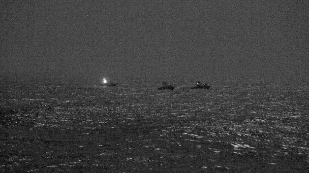 PHOTO: Three Iranian Islamic Revolutionary Guard Corps Navy approach the U.S. Coast Guard patrol boat while conducting routine maritime security patrols in the international waters of the North Arabian Gulf, April 26, 2021.  (U.S. Naval Forces Central Command/US Navy)