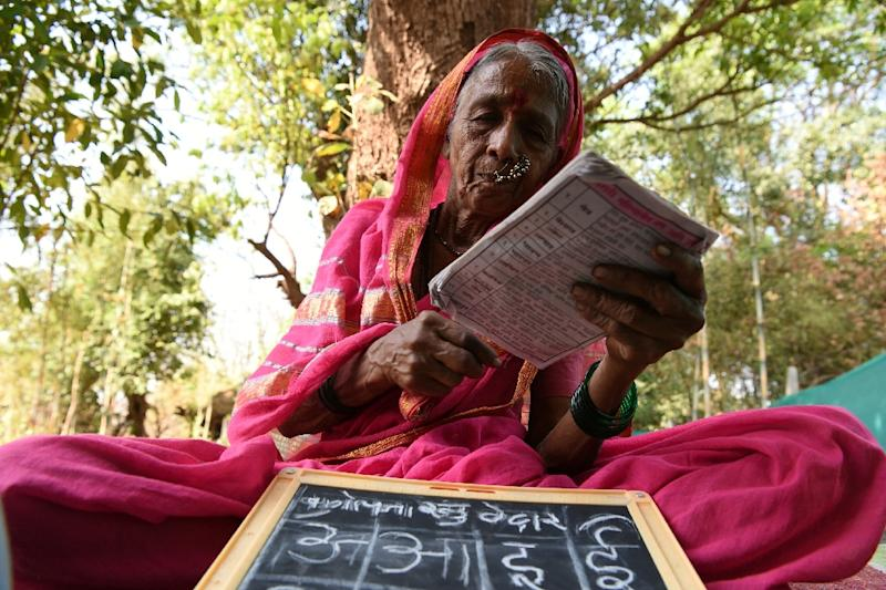 "The Aajibaichi Shala, or ""school for grannies"" in a village in Maharashtra gives elderly women an education they were denied as children (AFP Photo/Indranil MUKHERJEE)"