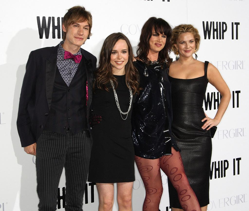 """<a href=""""http://movies.yahoo.com/movie/contributor/1810113895"""">Landon Pigg</a>, <a href=""""http://movies.yahoo.com/movie/contributor/1808438069"""">Ellen Page</a>, <a href=""""http://movies.yahoo.com/movie/contributor/1800019350"""">Juliette Lewis</a> and <a href=""""http://movies.yahoo.com/movie/contributor/1800016287"""">Drew Barrymore</a> at the Los Angeles premiere of <a href=""""http://movies.yahoo.com/movie/1810036665/info"""">Whip It!</a> - 09/29/2009"""