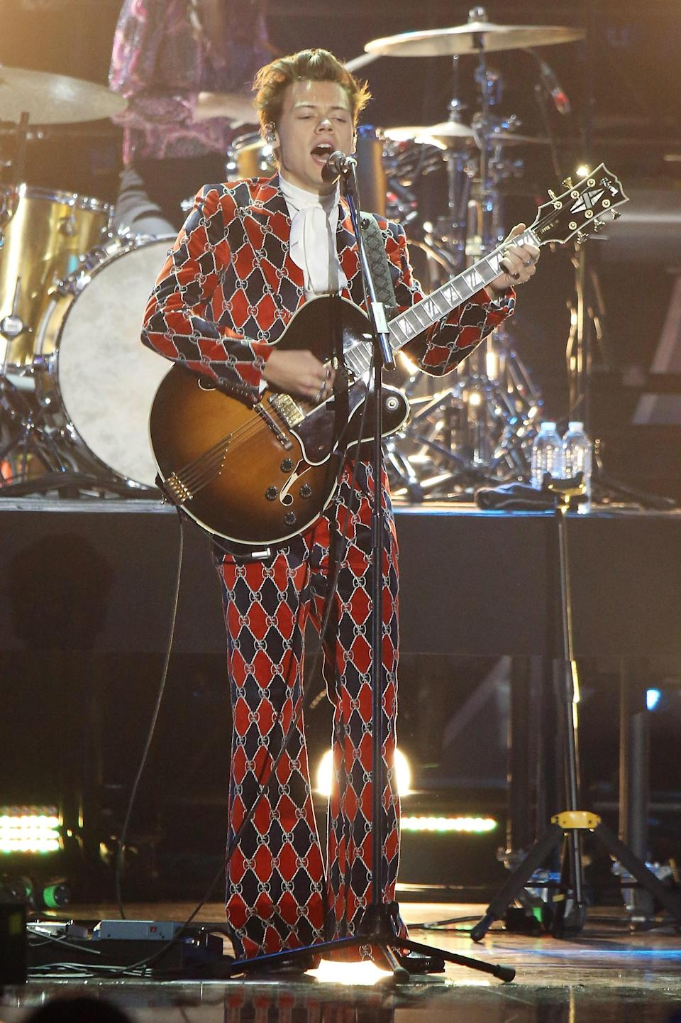 Printed suits? Check. Ruffled blouses? Double check. Harry Styles rules the red carpet in these campiest looks.