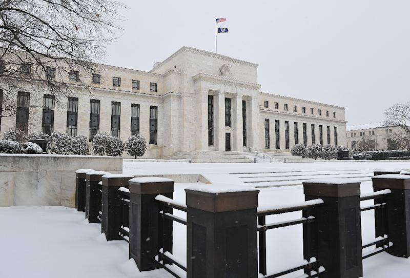 The US Federal Reserve is seen during a snow storm March 3, 2014 in Washington, DC (AFP Photo/Karen Bleier)