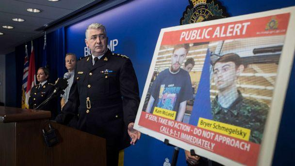 PHOTO: Security camera images recorded in Saskatchewan of Kam McLeod, 19, and Bryer Schmegelsky, 18, are displayed as Royal Canadian Mounted Police Assistant Commissioner Kevin Hackett steps away from the podium. (Darryl Dyck/The Canadian Press via AP)