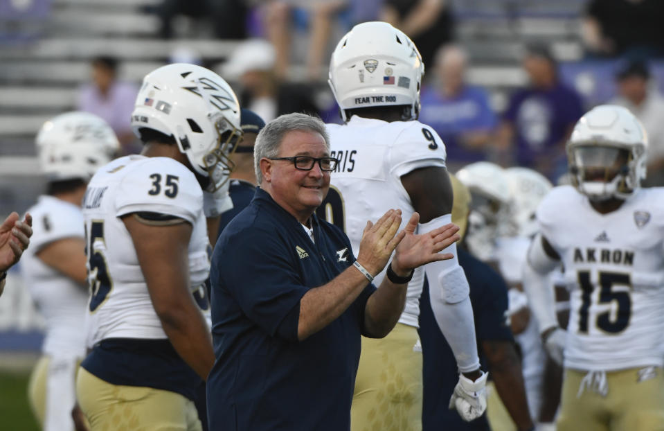 Akron head coach Terry Bowden with his team against Northwestern before an NCAA college football game in Evanston, Ill., Saturday, Sept. 15, 2018. (AP Photo/Matt Marton)