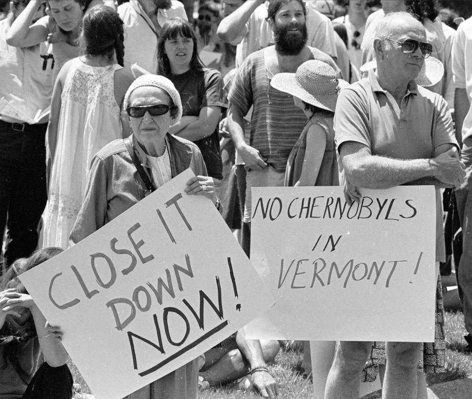 FILE - In this June 14, 1986 file photo, protestors stand at the Vermont Yankee nuclear power plant in Vernon, Vt. Vermont's only nuclear power plant will shut down by the end of 2014, ending a nasty legal battle over the future of the 4-decade-old plant, Entergy Corp. announced Tuesday, Aug. 27, 2013. The Vermont Yankee Nuclear Power Station is expected to cease power production after its current fuel cycle and will begin being decommissioned in the fourth quarter of 2014, the company said. (AP Photo/Toby Talbot, File)