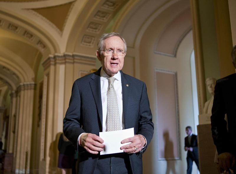 Senate Majority Leader Harry Reid of Nev. arrives to speak with reporters on Capitol Hill in Washington, Tuesday, July 23, 2013, after a Senate Democratic caucus. (AP Photo/J. Scott Applewhite)