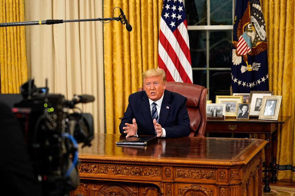 """US President Donald Trump addresses the Nation from the Oval Office about the widening novel coronavirus (Covid-19) crisis in Washington, DC on March 11, 2020. - President Donald Trump announced on March 11, 2020 the United States would ban all travel from Europe for 30 days starting to stop the spread of the coronavirus outbreak. """"To keep new cases from entering our shores, we will be suspending all travel from Europe to the United States for the next 30 days. The new rules will go into effect Friday at midnight,"""" Trump said in an address to the nation. (Photo by Doug Mills / POOL / AFP) (Photo by DOUG MILLS/POOL/AFP via Getty Images)"""