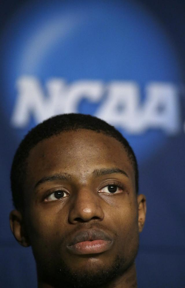 FILE - In this March 21, 2014, file photo, Oregon guard Johnathan Loyd listens to questions during a news conference for the third-round game of the NCAA college basketball tournament in Milwaukee. After four years as a point guard on Oregon's basketball team, Loyd is making the transition to receiver for the Ducks, taking advantage of an NCAA rule that allows a player a fifth year of eligibility _ in a different sport. (AP Photo/Morry Gash, File)