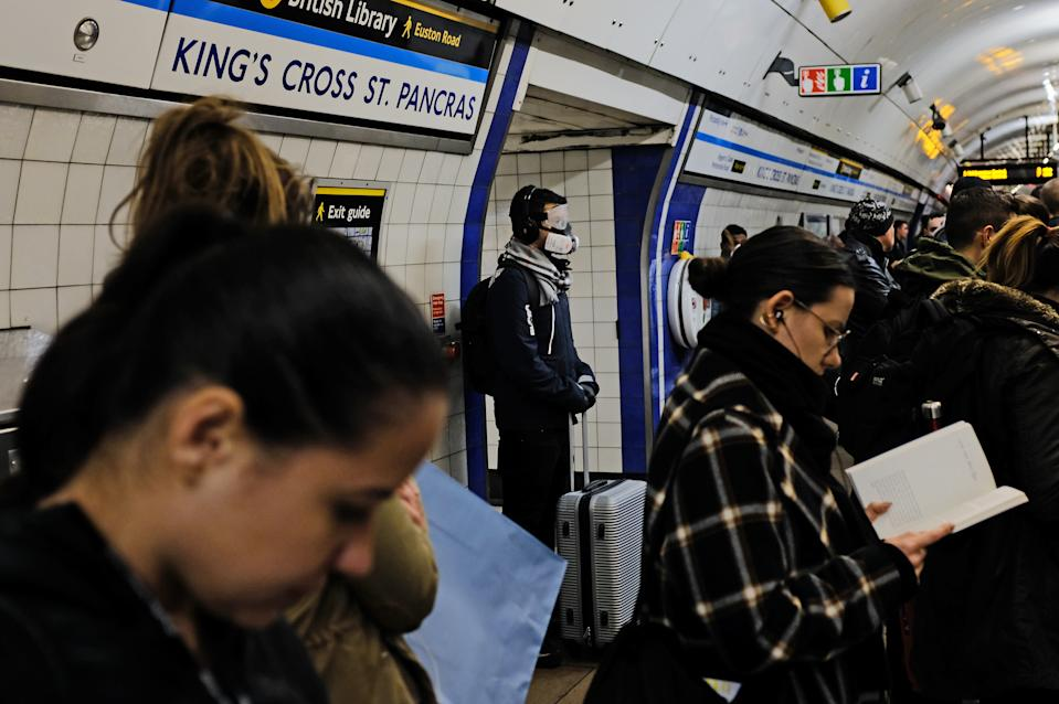 A person wearing a full face mask in King's Cross underground station in London after NHS England announced that the coronavirus death toll had reached 104 in the UK.