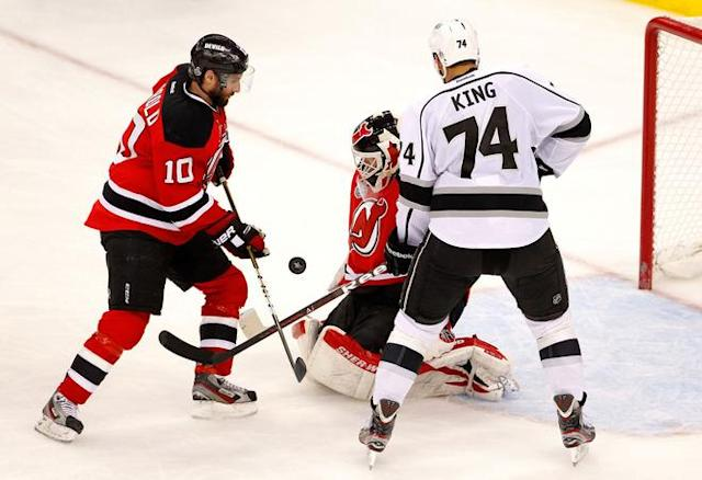 NEWARK, NJ - JUNE 02: Martin Brodeur #30 of the New Jersey Devils tries to make a save as Peter Harrold #10 of the New Jersey Devils and Dwight King #74 of the Los Angeles Kings look on during Game Two of the 2012 NHL Stanley Cup Final at the Prudential Center on June 2, 2012 in Newark, New Jersey. (Photo by Paul Bereswill/Getty Images)