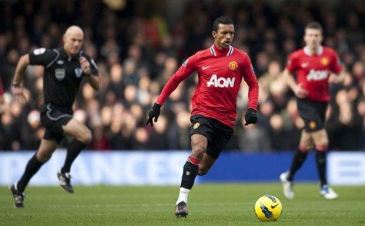 Manchester United midfielder Nani (C) said his best form remains elusive