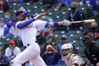 FILE - Chicago Cubs' Kris Bryant watches his hit during a baseball game against the Pittsburgh Pirates in Chicago, in this May 7, 2021, file photo. Bryant's versatility, while producing offensive numbers that belong alongside his NL MVP season in 2016, is a big reason why Chicago is on top of the NL Central once again, helping the Cubs go on a 21-9 run while dealing with a rash of injuries. (AP Photo/Charles Rex Arbogast, File)