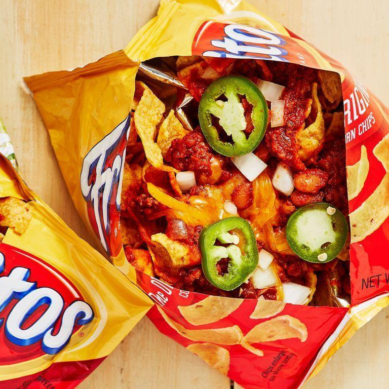 """<p>This genius invention calls for a freshly opened bag of Fritos topped with beef chili, cheese, onions, and jalapeños. Um, need we say more?!</p><p><em><a href=""""https://www.delish.com/cooking/recipe-ideas/a28914527/frito-pie-recipe/"""" rel=""""nofollow noopener"""" target=""""_blank"""" data-ylk=""""slk:Get the recipe from Delish »"""" class=""""link rapid-noclick-resp"""">Get the recipe from Delish »</a></em></p>"""