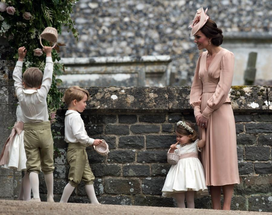 Kate Middleton went into serious mum mode on her sister's big day [Photo: PA]