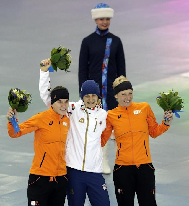 Standing left to right are silver medallist Ireen Wust of the Netherlands, gold medallist Martina Sablikova of the Czech Republic and bronze medallist Carien Kleibeuker of the Netherlands during the flower ceremony for the women's 5,000-meter speedskating race at the Adler Arena Skating Center during the 2014 Winter Olympics in Sochi, Russia, Wednesday, Feb. 19, 2014. (AP Photo/Matt Dunham)