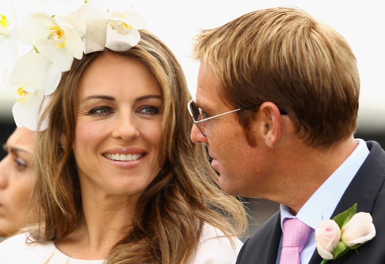 MELBOURNE, AUSTRALIA - NOVEMBER 03:  Shane Warne and Elizabeth Hurley look on at the Crown Oaks presentation during Crown Oaks Day at Flemington Racecourse on November 3, 2011 in Melbourne, Australia.  (Photo by Mark Dadswell/Getty Images)