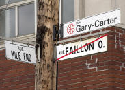 FILE - In this Tuesday, May 21, 2013, file photo, street signs are displayed where the city of Montreal has changed the name of Faillon Street to Gary Carter Street in honor of the late Gary Carter, in front of Jarry Park, the former home of the Montreal Expos, in Montreal. Now known as the Washington Nationals, the team is set to play in the franchise's first World Series. (Ryan Remiorz/The Canadian Press via AP, File)