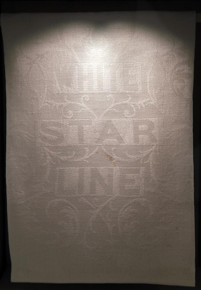 A White Star Line napkin is exhibited at the SeaCity Museum's Titanic exhibition on April 3, 2012 in Southampton, England. The new SeaCity Museum, which will open at 1.30pm on April 10, 100 years to the day since the Titanic set sail from the city. The museum, which cost 15 GBP million, promises to tell the largely untold story of Southampton's Titanic crew and the impact the tragedy had on the city, as well as featuring other aspects of the city's seafaring past.  (Photo by Matt Cardy/Getty Images)
