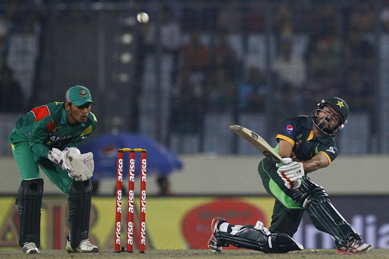 Pakistan's Fawad Alam, right, plays a shot, as Bangladesh's Anamul Haque watches during their match in the Asia Cup one-day international cricket tournament in Dhaka, Bangladesh, Tuesday, March 4, 2014. (AP Photo/A.M. Ahad)
