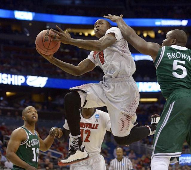 Louisville guard Terry Rozier (0) drives for the basket as Manhattan forward Rhamel Brown (5) defends during the first half in a second-round game in the NCAA college basketball tournament Thursday, March 20, 2014, in Orlando, Fla. (AP Photo/Phelan M. Ebenhack)