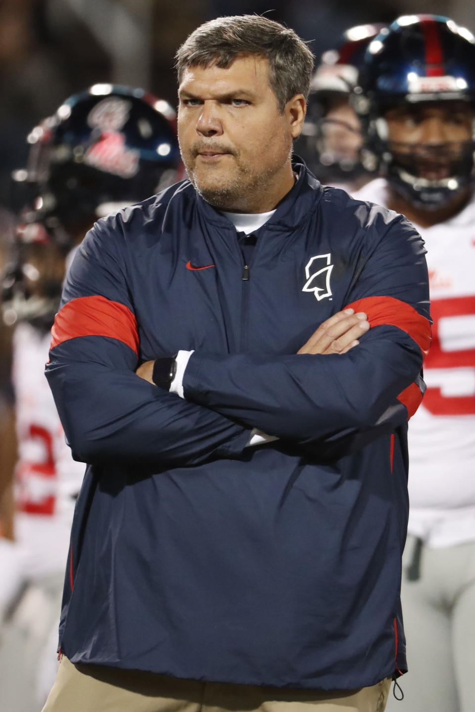 In this Nov. 28, 2019 photo, Mississippi head coach Matt Luke watches his players warm up prior to an NCAA college football game against Mississippi State, in Starkville, Miss. Mississippi has fired Luke, three days after his third non-winning season ended with an excruciating rivalry game loss. Athletic director Keith Carter said Sunday, Dec. 1, 2019 the decision to change coaches was made after evaluating the trajectory of the program and not seeing enough momentum on the field. (AP Photo/Rogelio V. Solis)