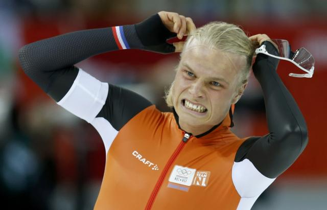 Koen Verweij of the Netherlands reacts to narrowly missing out on first place to be placed second in the men's 1,500 metres speed skating race during the 2014 Sochi Winter Olympics