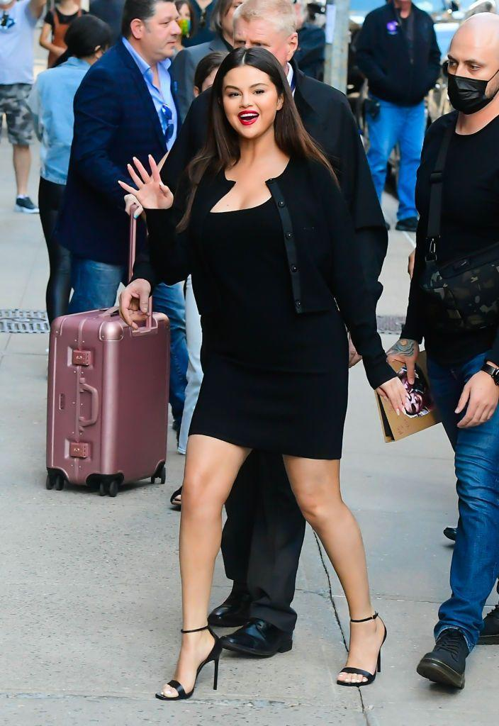 """<p>Heading into the television studios in New York City, Gomez went for an all-black look again, this time wearing a black mini dress and cardigan combo by Victor Glemaud.</p><p><a class=""""link rapid-noclick-resp"""" href=""""https://go.redirectingat.com?id=127X1599956&url=https%3A%2F%2Fwww.farfetch.com%2Fuk%2Fshopping%2Fwomen%2Fvictor-glemaud-square-neck-dress-item-17041692.aspx&sref=https%3A%2F%2Fwww.elle.com%2Fuk%2Ffashion%2Fcelebrity-style%2Farticles%2Fg10775%2Fselena-gomez-style-file-red-carpet-dresses-street-style%2F"""" rel=""""nofollow noopener"""" target=""""_blank"""" data-ylk=""""slk:SHOP NOW"""">SHOP NOW</a> Victor Glemaud square neck dress, £517</p><p><a class=""""link rapid-noclick-resp"""" href=""""https://go.redirectingat.com?id=127X1599956&url=https%3A%2F%2Fwww.farfetch.com%2Fuk%2Fshopping%2Fwomen%2Fvictor-glemaud-concealed-front-cardigan-item-17042749.aspx%3Fstoreid%3D13706&sref=https%3A%2F%2Fwww.elle.com%2Fuk%2Ffashion%2Fcelebrity-style%2Farticles%2Fg10775%2Fselena-gomez-style-file-red-carpet-dresses-street-style%2F"""" rel=""""nofollow noopener"""" target=""""_blank"""" data-ylk=""""slk:SHOP NOW"""">SHOP NOW</a> Victor Glemaud concealed-front cardigan, £524<br></p>"""