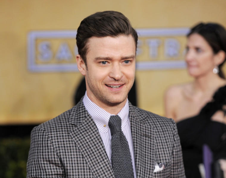 FILE - This Jan. 27, 2013 file photo shows actor-singer Justin Timberlake at the 19th Annual Screen Actors Guild Awards at the Shrine Auditorium in Los Angeles. The Recording Academy announced Wednesday, Jan. 30, that the pop star will perform at the awards show on Feb. 10. (Photo by Chris Pizzello/Invision/AP)