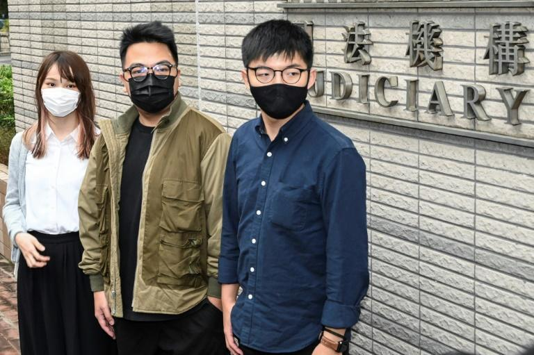 Agnes Chow (left), Ivan Lam (centre) and Joshua Wong (right) were jailed after pleading guilty to inciting an illegal assembly
