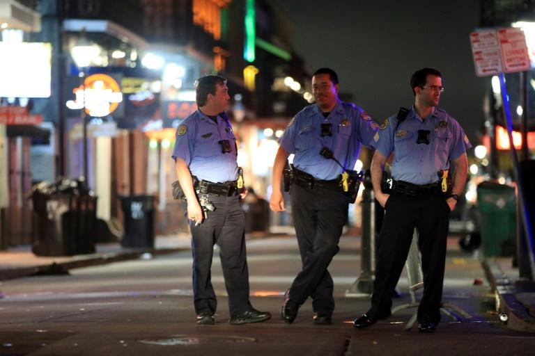 New Orleans police officers patrol an empty Bourbon Street after Louisiana Governor John Bel Edwards ordered the closure of all bars and restaurants because of the coronavirus outbreak