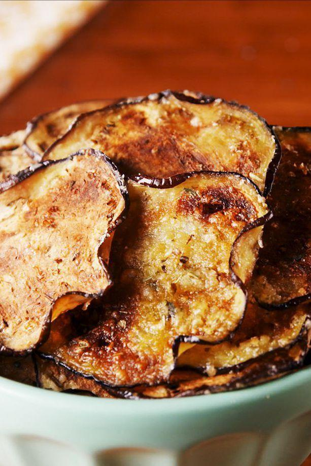 """<p>The parmesan gives them an added flavor boost!</p><p>Get the recipe from <a href=""""https://www.delish.com/cooking/recipe-ideas/a26279452/eggplant-parm-chips-recipe/"""" rel=""""nofollow noopener"""" target=""""_blank"""" data-ylk=""""slk:Delish"""" class=""""link rapid-noclick-resp"""">Delish</a>.</p>"""